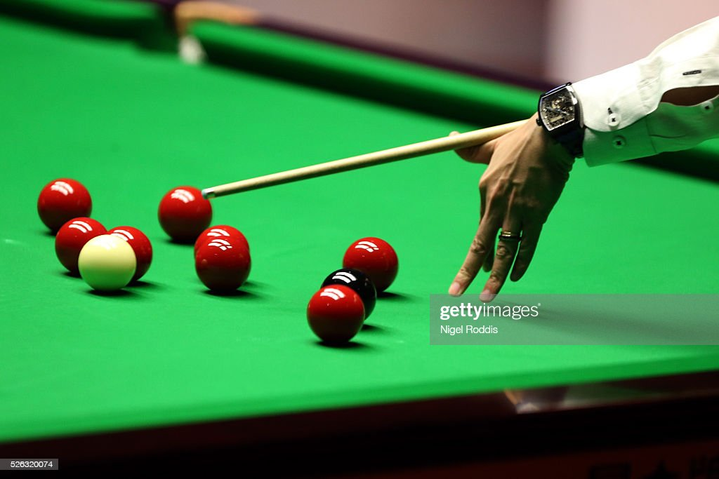 Marco Fu of Hong Kong in action during his semi final match against Mark Selby of England on day fifteen of the World Championship Snooker at Crucible Theatre on April 30, 2016 in Sheffield, England.