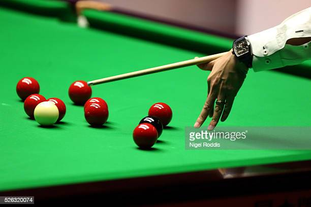 Marco Fu of Hong Kong in action during his semi final match against Mark Selby of England on day fifteen of the World Championship Snooker at...