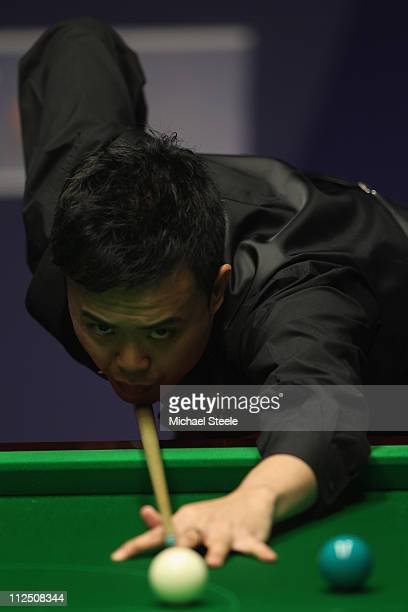 Marco Fu of Hong Kong in action during the round one game against Martin Gould of England on day four of the Betfredcom World Snooker Championship at...