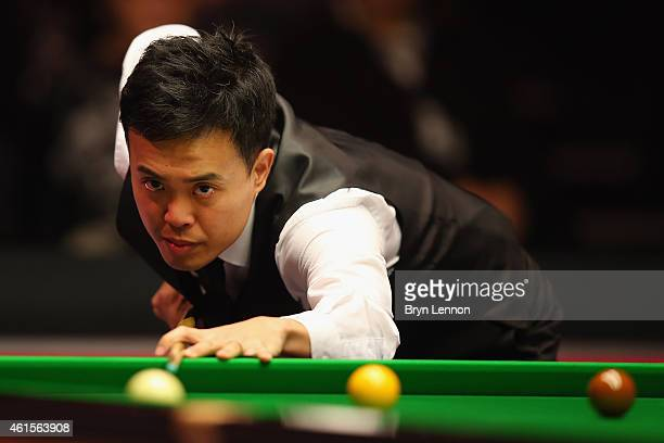Marco Fu of Hong Kong in action in his quarterfinal match against Ronnie O'Sullivan on Day Five of the 2015 Dafabet Masters at Alexandra Palace on...
