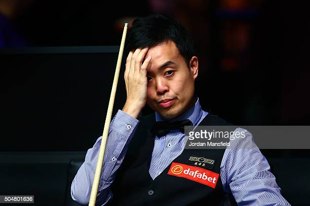 Marco Fu of Hong Kong looks dejected in his first round match against Neil Robertson of Australia during Day Four of the Dafabet Masters at Alexandra...