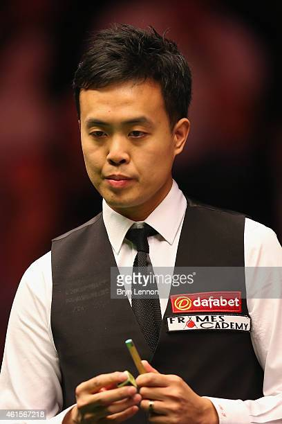 Marco Fu of Hong Kong looks on during his quarterfinal match against Ronnie O'Sullivan on Day Five of the 2015 Dafabet Masters at Alexandra Palace on...