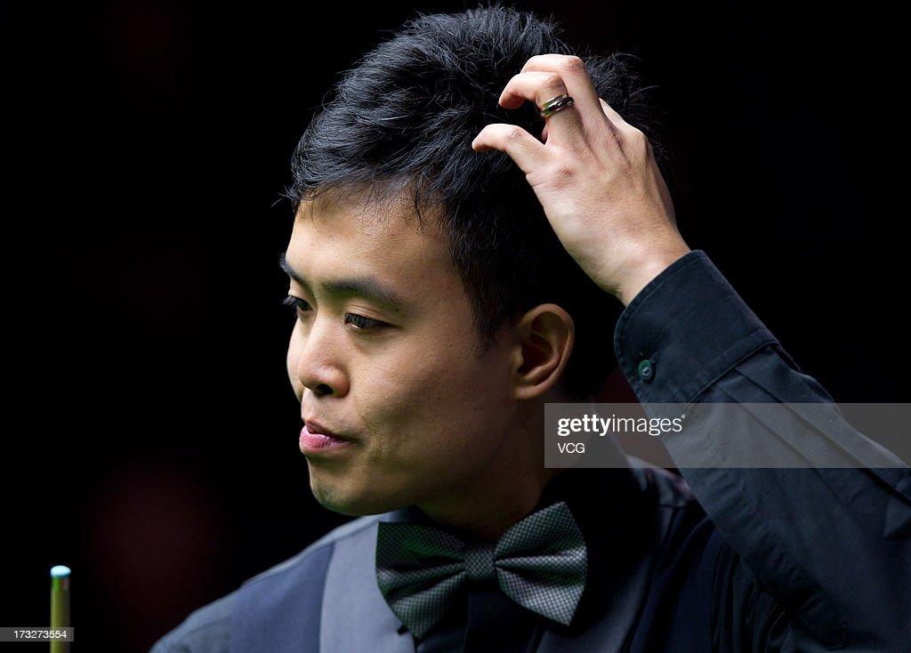 Marco Fu of Hong Kong looks on during the match against Shaun Murphy of England on day three of the World Snooker Australia Open at the Bendigo Stadium on July 11, 2013 in Bendigo, Australia.