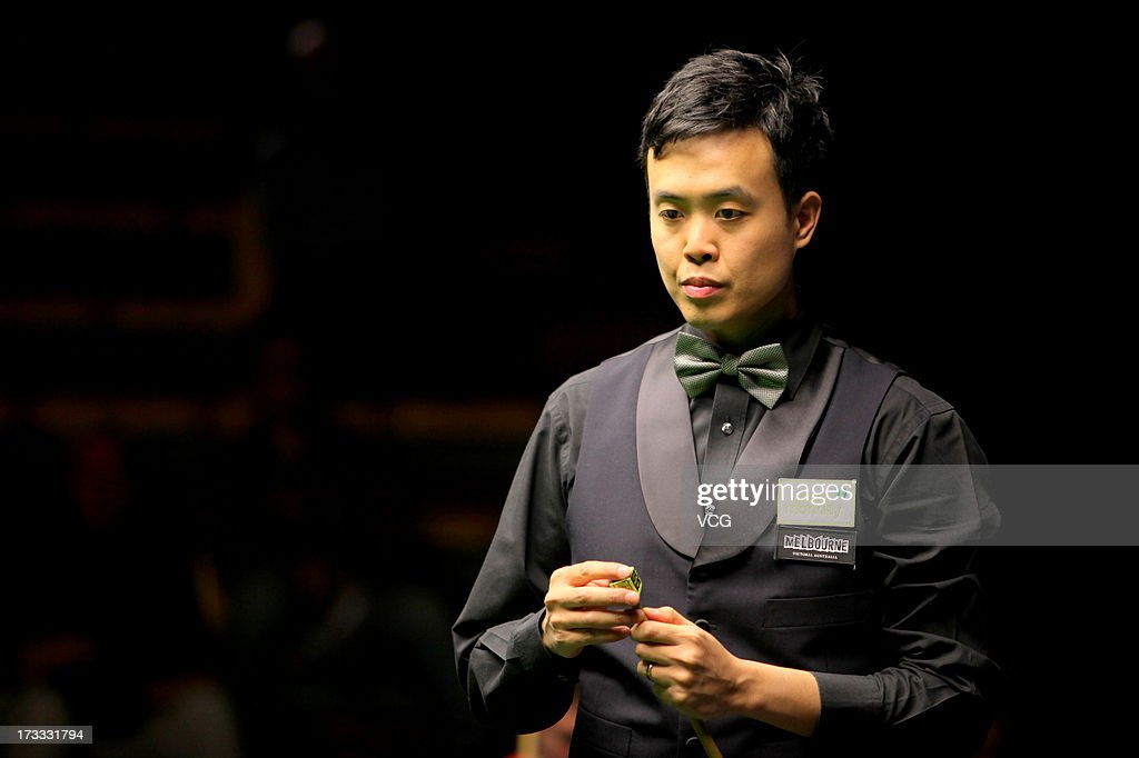 <a gi-track='captionPersonalityLinkClicked' href=/galleries/search?phrase=Marco+Fu&family=editorial&specificpeople=221154 ng-click='$event.stopPropagation()'>Marco Fu</a> of Hong Kong looks on during the quarter-final match against Dominic Dale of Wales on day four of the World Snooker Australia Open at the Bendigo Stadium on July 12, 2013 in Bendigo, Australia.