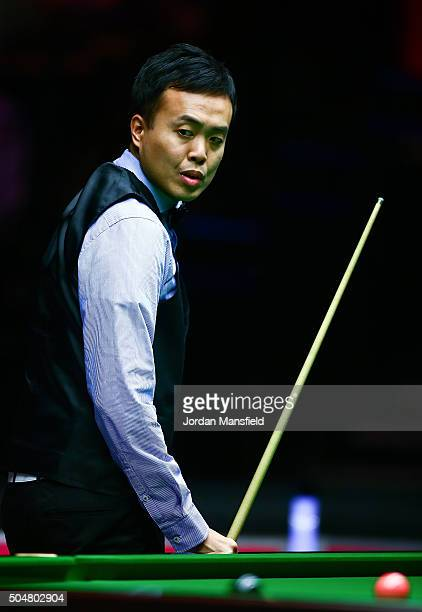 Marco Fu of Hong Kong looks on in his first round match against Neil Robertson of Australia during Day Four of the Dafabet Masters at Alexandra...