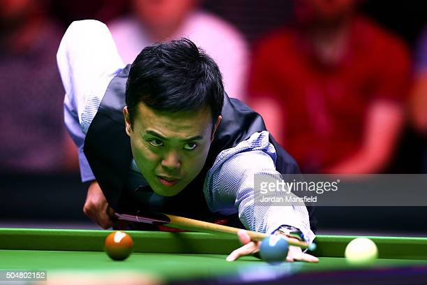 Marco Fu of Hong Kong looks plays a shot first round match against Neil Robertson of Australia during Day Four of the Dafabet Masters at Alexandra...