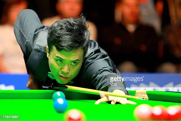 Marco Fu of Hong Kong plays a shot during the final match against Neil Robertson of Australia during the World Snooker Australia Open at the Bendigo...