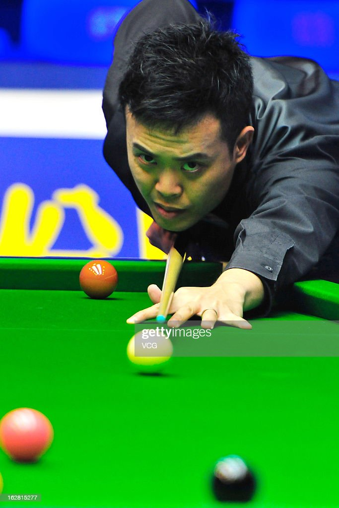 Marco Fu of Hong Kong plays a shot during the match against Mark Williams of Wales on day three of the 2013 World Snooker Haikou Open at Haikou Convention and Exhibition Center on February 27, 2013 in Haikou, China.