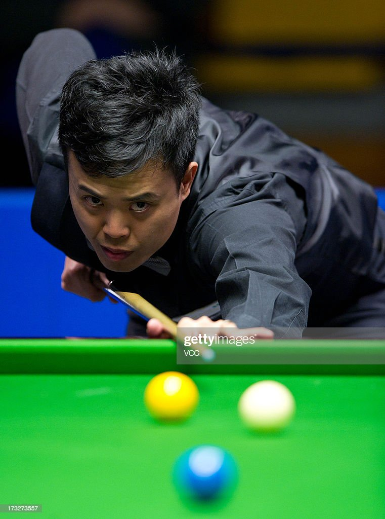 <a gi-track='captionPersonalityLinkClicked' href=/galleries/search?phrase=Marco+Fu&family=editorial&specificpeople=221154 ng-click='$event.stopPropagation()'>Marco Fu</a> of Hong Kong plays a shot during the match against Shaun Murphy of England on day three of the World Snooker Australia Open at the Bendigo Stadium on July 11, 2013 in Bendigo, Australia.