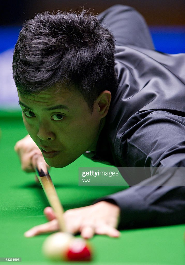 Marco Fu of Hong Kong plays a shot during the match against Shaun Murphy of England on day three of the World Snooker Australia Open at the Bendigo Stadium on July 11, 2013 in Bendigo, Australia.