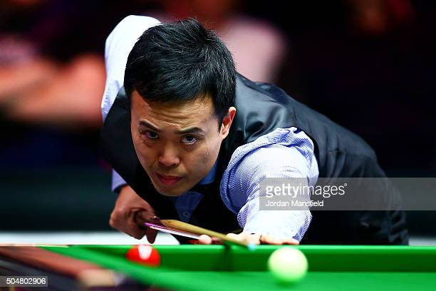 Marco Fu of Hong Kong plays a shot in his first round match against Neil Robertson of Australia during Day Four of the Dafabet Masters at Alexandra...