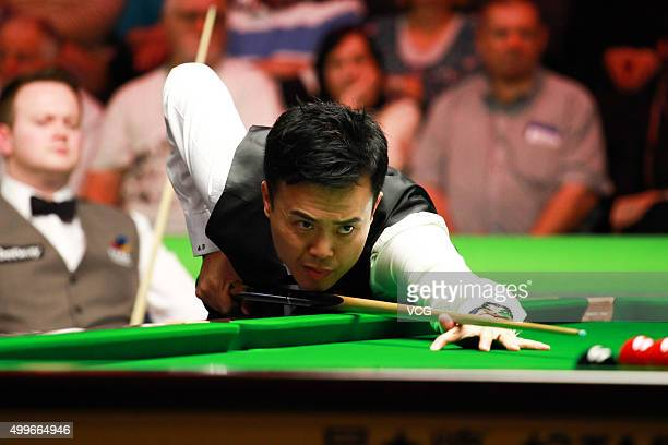 Marco Fu of Hong Kong plays a shot in his match against Shaun Murphy of England on day eight of Betway UK Championship at Barbican Centre on December...