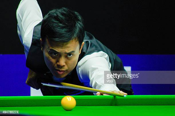 Marco Fu of Hong Kong plays a shot in the match against David Gilbert of England on day 5 of Snooker International Championship 2015 at Baihu Media...