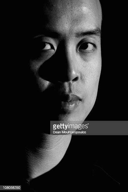 Marco Fu of Hong Kong poses for a photo after his victory against Mark Allen of Northern Ireland in the semi final of The Ladbrokesmobile Masters on...