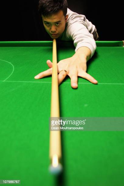 Marco Fu of Hong Kong poses on the practice table during The Ladbrokesmobile Masters on Day 3 at Wembley Arena on January 11 2011 in London England