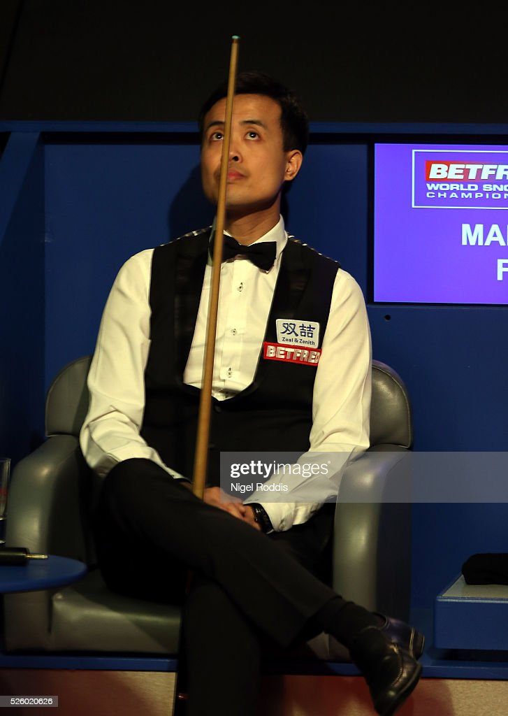 Marco Fu of Hong Kong reacts during his semi final match against Mark Selby of England on day fourteen of the World Championship Snooker at Crucible Theatre on April 29, 2016 in Sheffield, England.