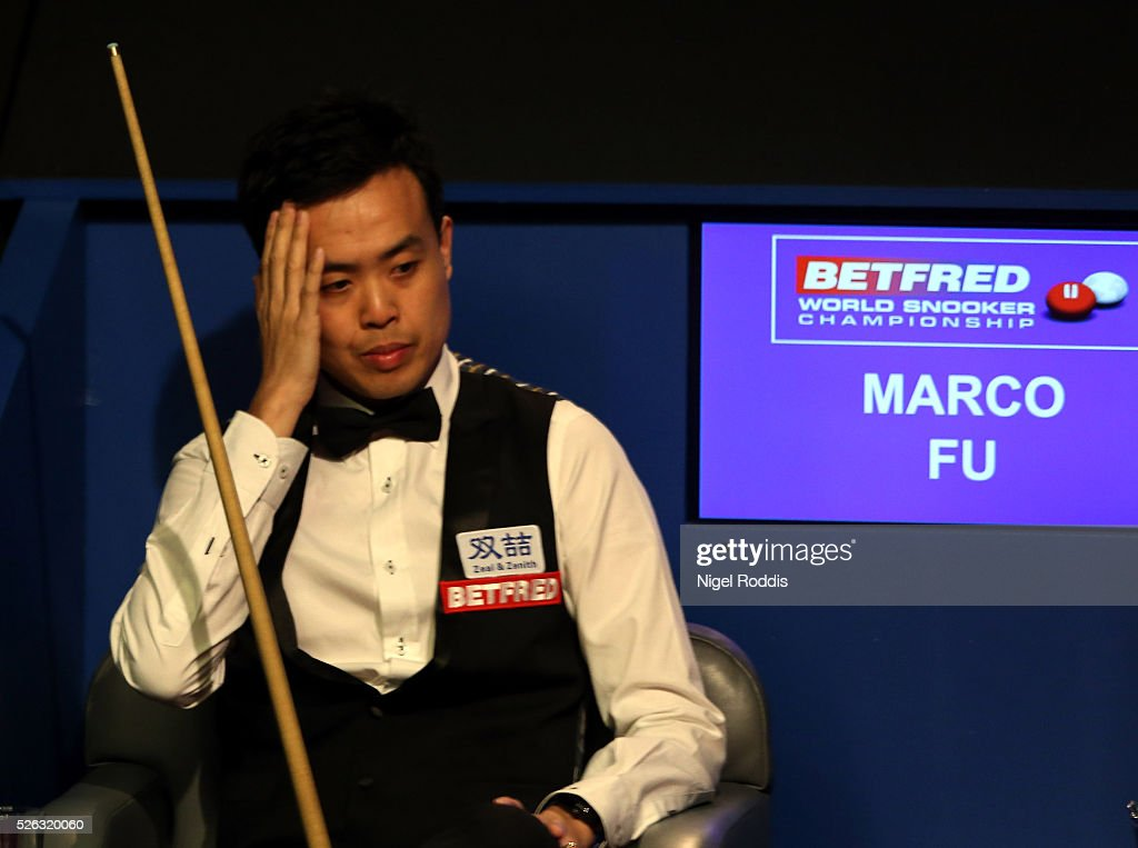 Marco Fu of Hong Kong reacts during his semi final match against Mark Selby of England on day fifteen of the World Championship Snooker at Crucible Theatre on April 30, 2016 in Sheffield, England.