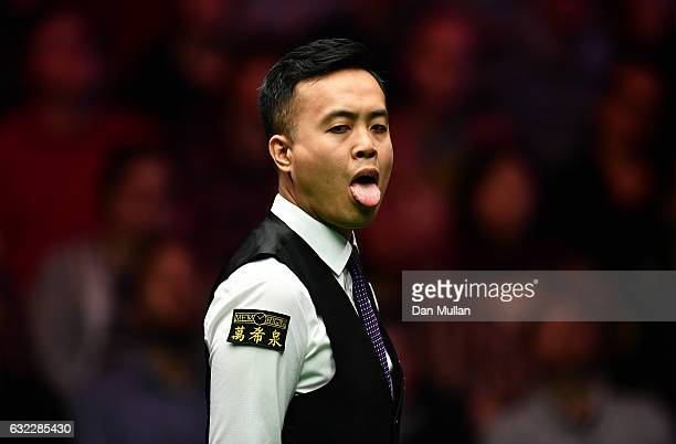 Marco Fu of Hong Kong reacts during his semi final match against Ronnie O'Sullivan of England on day seven of the Dafabet Masters at Alexandra Palace...