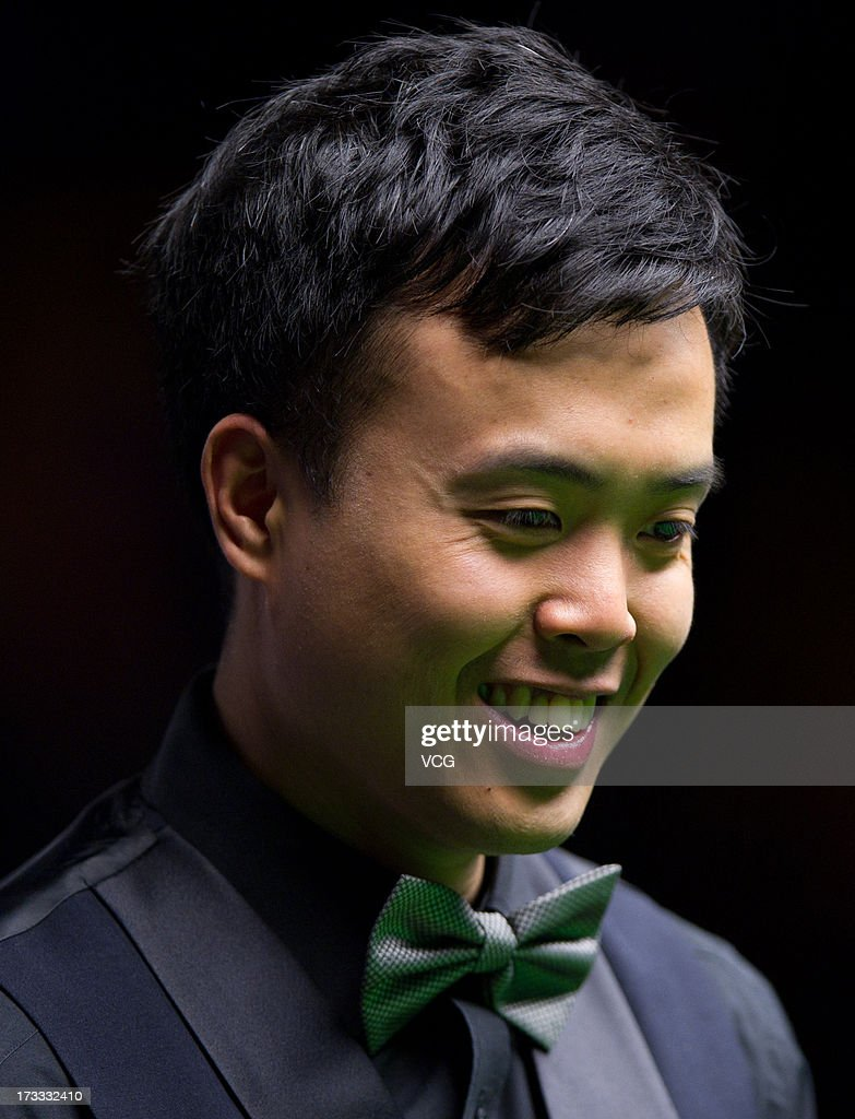 <a gi-track='captionPersonalityLinkClicked' href=/galleries/search?phrase=Marco+Fu&family=editorial&specificpeople=221154 ng-click='$event.stopPropagation()'>Marco Fu</a> of Hong Kong reacts during the quarter-final match against Dominic Dale of Wales on day four of the World Snooker Australia Open at the Bendigo Stadium on July 12, 2013 in Bendigo, Australia.