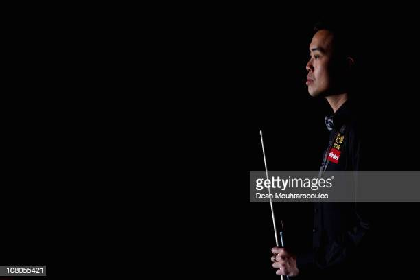 Marco Fu of Hong Kong waits to be introduced for his match against Mark Allen of Northern Ireland in the semi final of The Ladbrokesmobile Masters on...