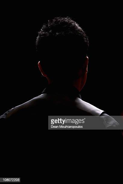 Marco Fu of Hong Kong watches Ding Junhui of China in the Final of The Ladbrokesmobile Masters on Day 8 at Wembley Arena on January 16 2011 in London...