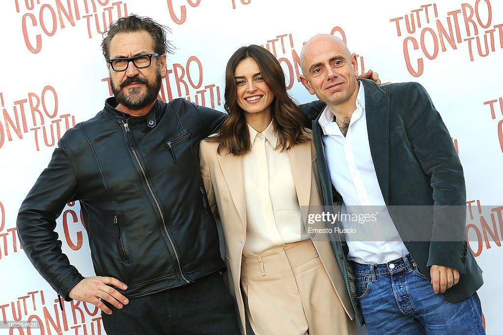 Marco Giallini Kasia Smutniak and Rolando Ravello attend the 'Tutti Contro Tutti' photocall at Space Moderno on February 21 2013 in Rome Italy