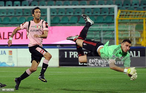 Marco Giovio of Palermo scores the equalizing goal past goalkeeper Antonio Donnarumma of Milan during the Juvenile Tim Cup Final First Leg match...