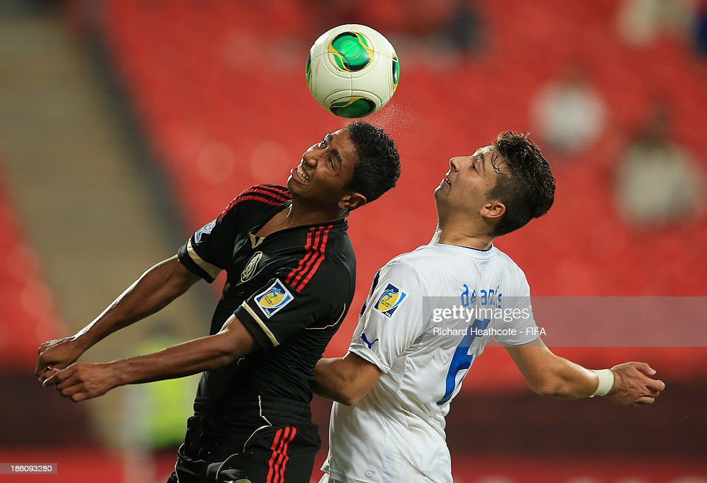 Marco Granados of Mexico battles with Ivan De Santis of Italy during the FIFA U-17 World Cup UAE 2013 Round of 16 match between Italy and Mexico at the Mohamed Bin Zayed Stadium on October 28, 2013 in Abu Dhabi, United Arab Emirates.