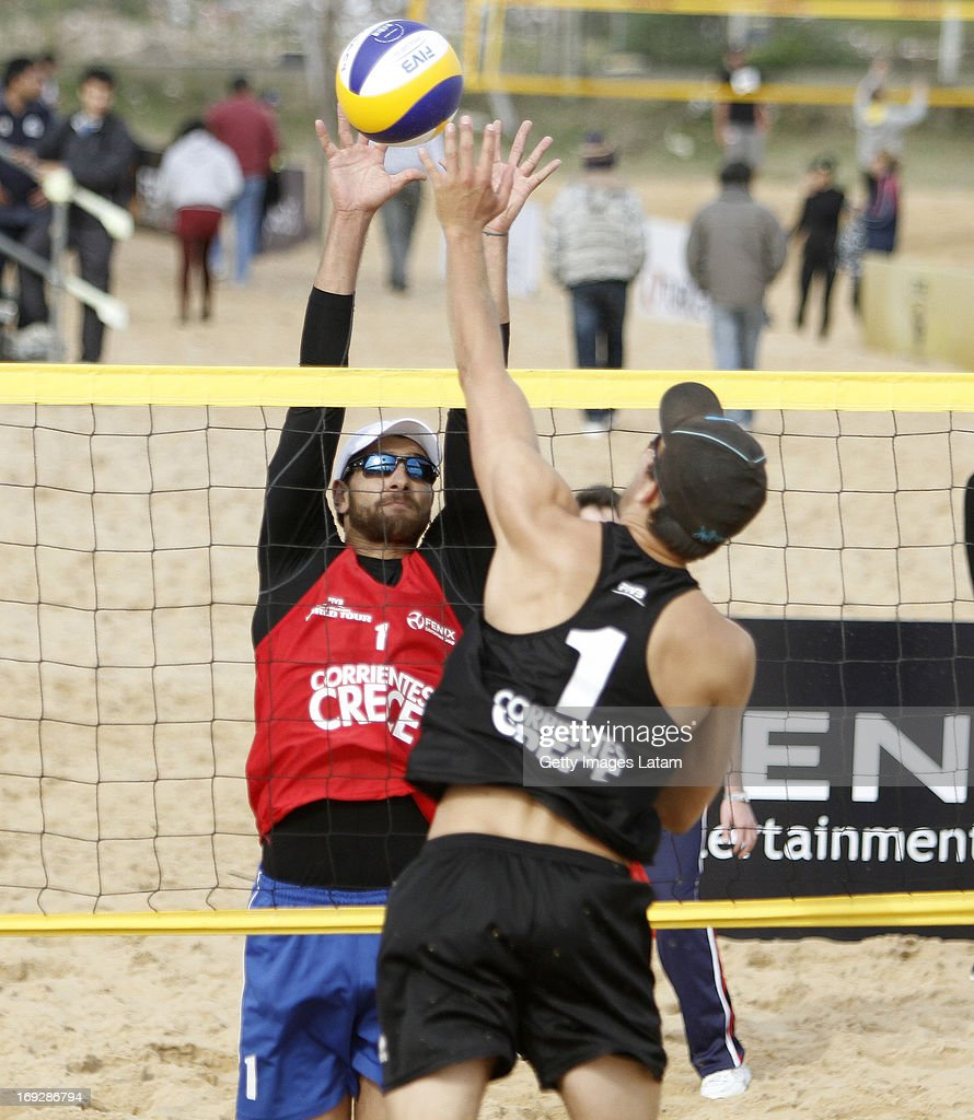 Marco Grimalt (in red) of Chile blocks an attack of Henning Kjemperud (in black) of (Norway) during a match between Chile and Norway as part of day one of Corrientes Grand Slam of FIVB World Tour at Arazaty Beach on May 22, 2013 in Corrientes, Argentina.