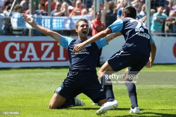 Marco Gruettner of Kickers celebrates his goal with Mahir Savranlioglu of Kickers during the Third League match between VfB Stuttgart II and...