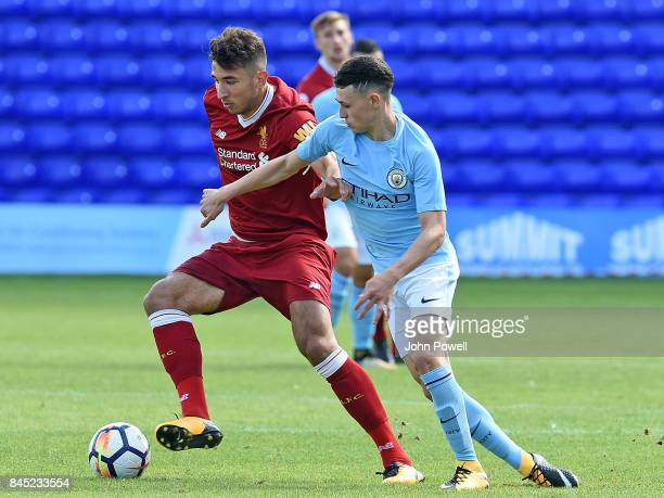 OUT Marco Grujic of Liverpool with Phil Foden of Manchester City during the game at Prenton Park on September 10 2017 in Birkenhead England