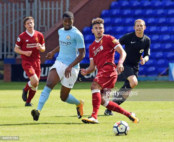 OUT Marco Grujic of Liverpool with Sadou Diallo of Manchester City during the game at Prenton Park on September 10 2017 in Birkenhead England