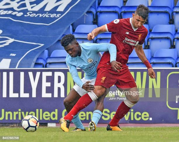OUT Marco Grujic of Liverpool with Tomiwa DeleBashiru of Manchester City during the game at Prenton Park on September 10 2017 in Birkenhead England