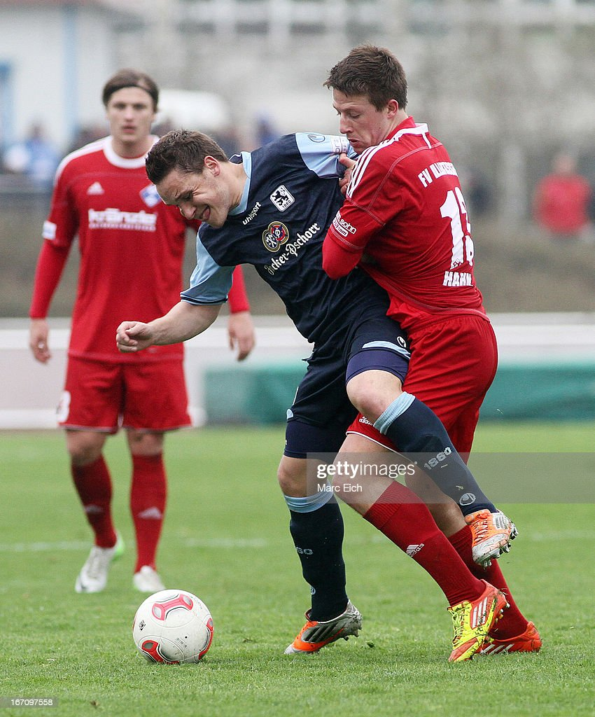 Marco Hahn of Illertissen (R) challenges Andreas Geipl of Muenchen (L) during the Regionalliga Bayern match between FV Illertissen and 1860 Muenchen II at Voehlinstadion on April 20, 2013 in Illertissen, Germany.