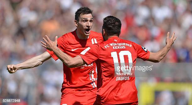 Marco Haller of Wuerzburg celebrates with Nejmeddin Daghfous of Wuerzburg after scoring his team's first goal during the Third League match between...