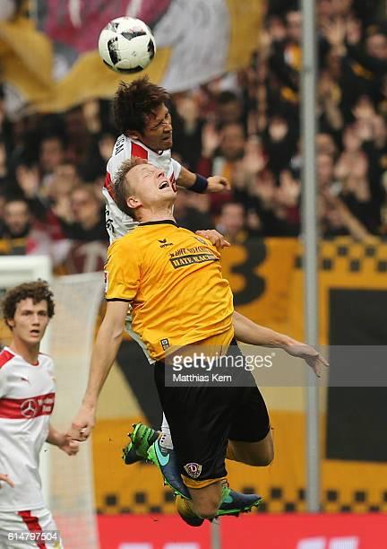 Marco Hartmann of Dresden and Hajime Hosogai of Stuttgart jump for a header during the Second Bundesliga match between SG Dynamo Dresden and VfB...