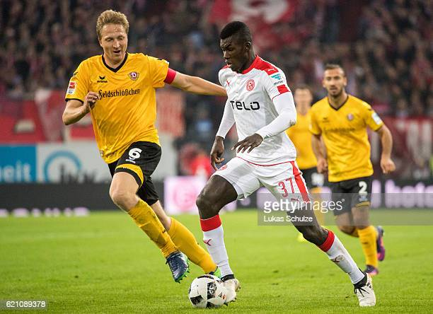 Marco Hartmann of Dresden and Ihlas Bebou of Duesseldorf in action during the Second Bundesliga match between Fortuna Duesseldorf and SG Dynamo...
