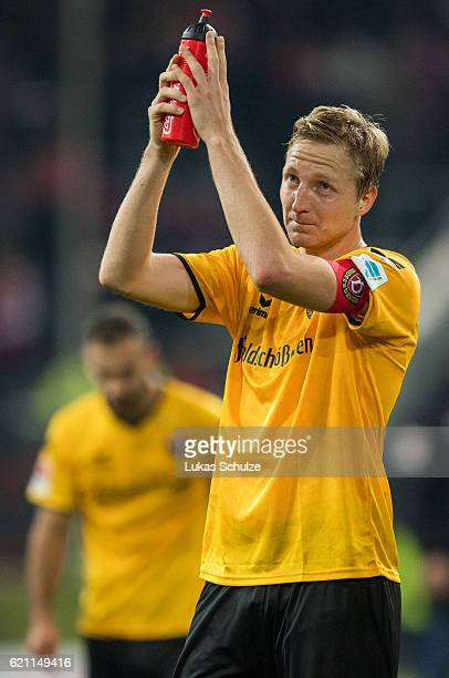 Marco Hartmann of Dresden applauds after the Second Bundesliga match between Fortuna Duesseldorf and SG Dynamo Dresden at EspritArena on November 4...