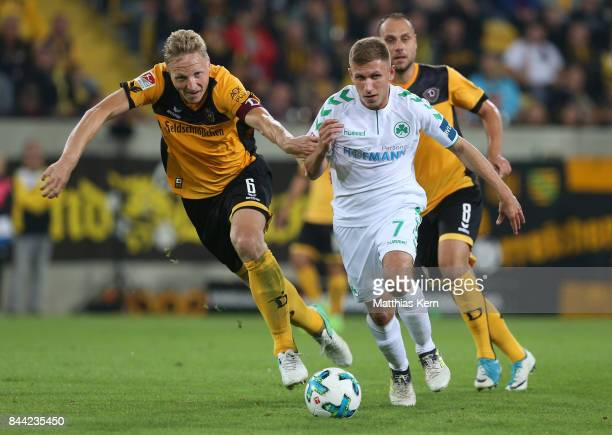 Marco Hartmann of Dresden battles for the ball with Levent Aycicek of Fuerth during the Second Bundesliga match between SG Dynamo Dresden and SpVgg...