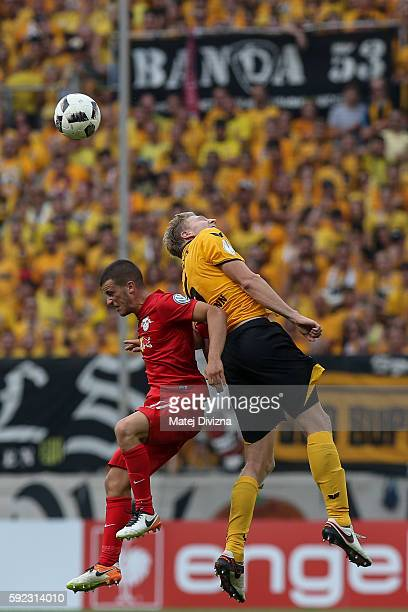 Marco Hartmann of Dresden competes for the ball with Diego Demme of Leipzig during the DFB Cup match between Dynamo Dresden and RB Leipzig at...
