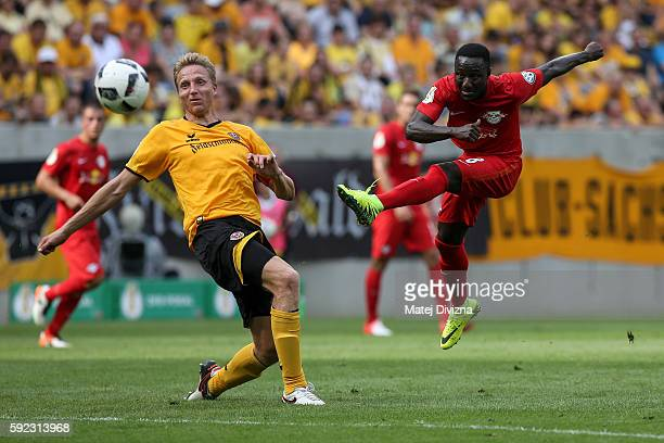 Marco Hartmann of Dresden competes for the ball with Naby Deco Keita of Leipzig during the DFB Cup match between Dynamo Dresden and RB Leipzig at...