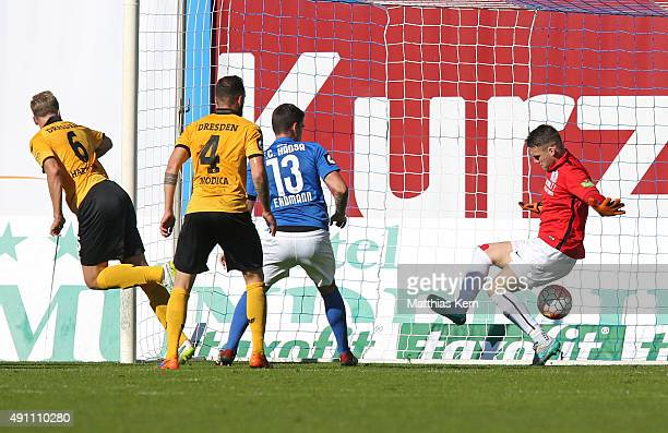 Marco Hartmann of Dresden scores the first goal during the third league match between FC Hansa Rostock and SG Dynamo Dresden at Ostseestadion on...