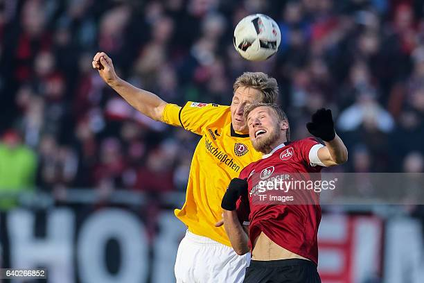 Marco Hartmann of Dynamo Dresden and Hanno Behrens of FC Nuernberg battle for the ball during the Second Bundesliga match between 1 FC Nuernberg and...
