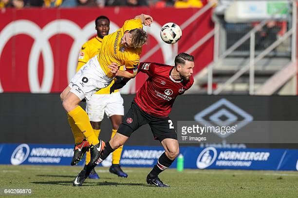 Marco Hartmann of Dynamo Dresden and Tim Matavz of FC Nuernberg battle for the ball during the Second Bundesliga match between 1 FC Nuernberg and SG...