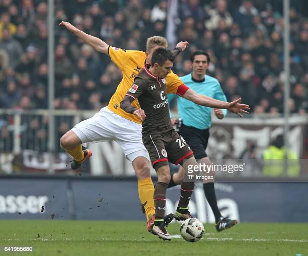 Marco Hartmann of Dynamo Dresden and Waldemar Sobota of St Pauli battle for the ball during the Second Bundesliga match between FC St Pauli and SG...