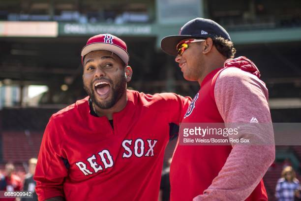 Marco Hernandez and Pablo Sandoval of the Boston Red Sox react during batting practice before a game against the Tampa Bay Rays on April 15 2017 at...