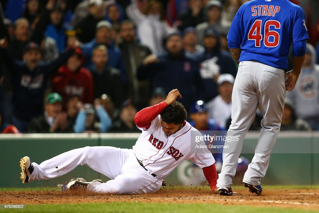 Marco Hernandez #40 slides into home plate in the eighth inning of a game against the Chicago Cubs at Fenway Park on April 30, 2017 in Boston, Massachusetts.