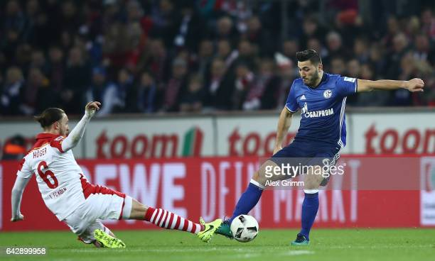 Marco Hger of Koeln is challenged by Sead Kolasinac of Schalke during the Bundesliga match between 1 FC Koeln and FC Schalke 04 at...
