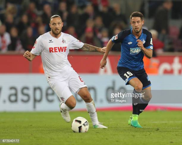 Marco Hoeger and MarkAlexander Uth battle for the ball during the Bundesliga match between 1 FC Koeln and TSG 1899 Hoffenheim at RheinEnergieStadion...