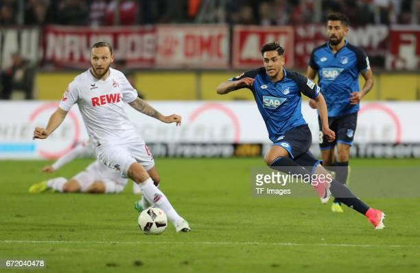 Marco Hoeger and Nadiem Amiri battle for the ball during the Bundesliga match between 1 FC Koeln and TSG 1899 Hoffenheim at RheinEnergieStadion on...